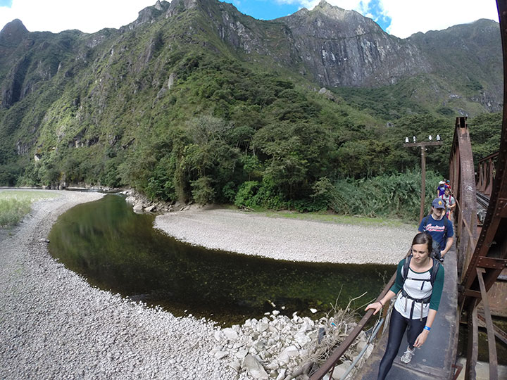 inca jungle third day: Crossing the bridge of the river vilcanota with direction to Aguas Calientes